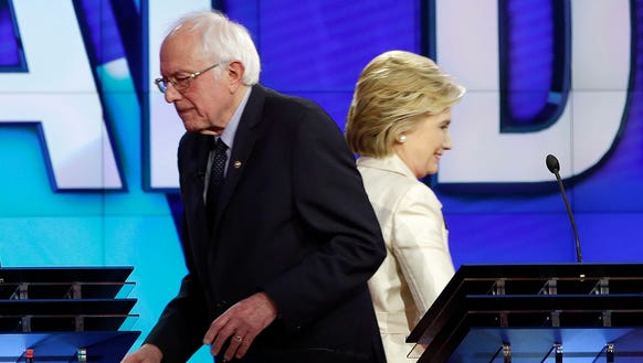 Bernie Sanders and Hillary Clinton pass each other
