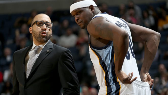 Memphis Grizzlies Zach Randolph (right) talks with head coach David Fizdale as Randolph checks into the game against the Philadelphia 76ers.