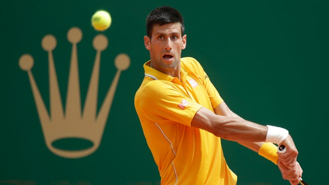 Novak Djokovic of Serbia plays a return to Marin Cilic of Croatia during their quarterfinal match at the Monte Carlo Tennis Masters tournament in Monaco, Friday, April 17, 2015. (AP Photo/Lionel Cironneau)