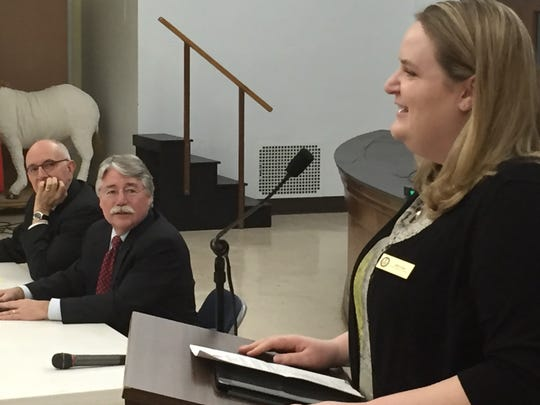 Kelly Griese, investor education coordinator for Secretary of State Conie Lawson's office, offers investment safety tips while Marion County Prosecutor Terry Curry, left, and Attorney General Greg Zoeller listen.