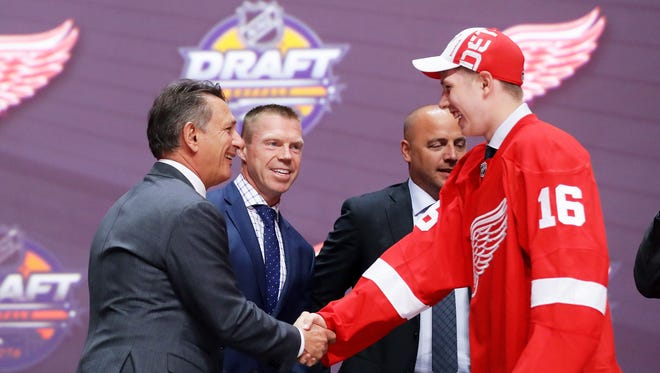 Dennis Cholowski celebrates with the Detroit Red Wings after being selected 20th overall during round one of last year's NHL Draft.