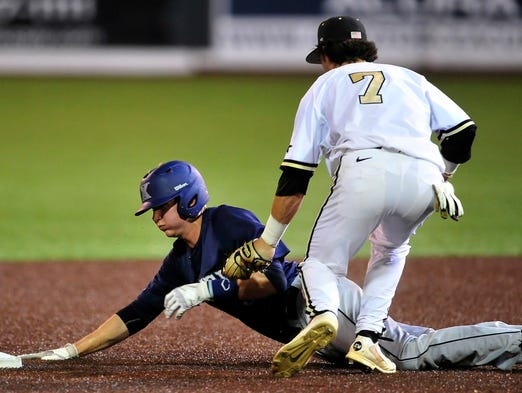 Vanderbilt's Dansby Swanson, right, tags out Xavier's Daniel Rizzie during the NCAA Regional Tournament game at Hawkins Field on Friday.