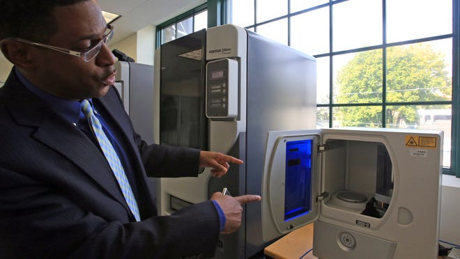Brian Merritt, director of the Haverstraw Extension Center, with the scanner in Rockland Community College's 3-D printing lab in Haverstraw.