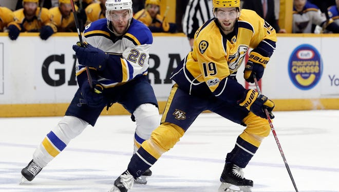 Nashville Predators center Calle Jarnkrok (19), of Sweden, is defended by St. Louis Blues' Paul Stastny (26) during the second period in Game 6 of a second-round NHL hockey playoff series Sunday, May 7, 2017, in Nashville, Tenn. (AP Photo/Mark Humphrey)