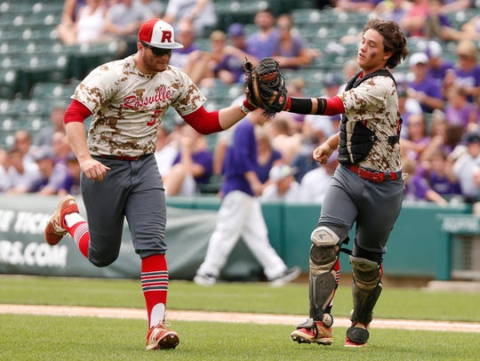 Rossville catcher Corbin Beard, right, celebrates with