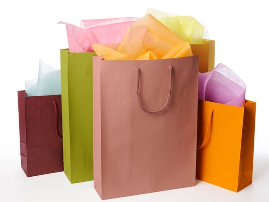 Isolated shot of colorful shopping bags on white background