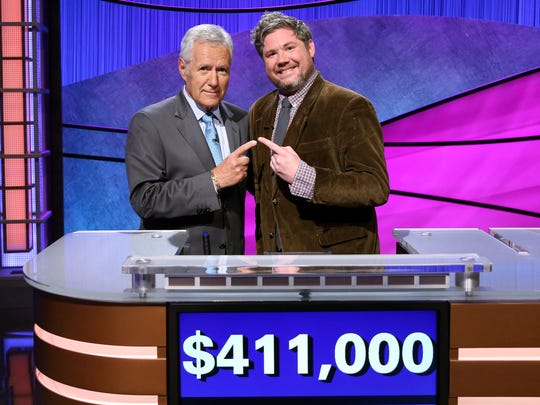 Jeopardy! host Alex Trebek, left, stands with contestant Austin Rogers, whose 12-game winning streak came to an end Thursday, Oct. 12, 2017.