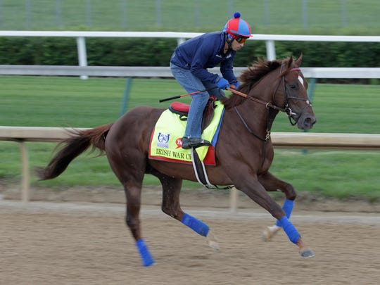 Irish War Cry runs on the track during the Wednesday morning training for the Kentucky Derby at Churchill Downs.