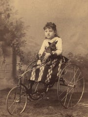 Little girl on a Fairy tricycle, circa 1900.