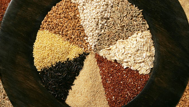 Look beyond white rice and discover better nutrition and taste from grains. From the top going clockwise are: barley, rye berries, oats, red quinoa, amaranth whole grain, wild rice, millet and red winter wheat berries. (Karen Schiely/Akron Beacon Journal/MCT)