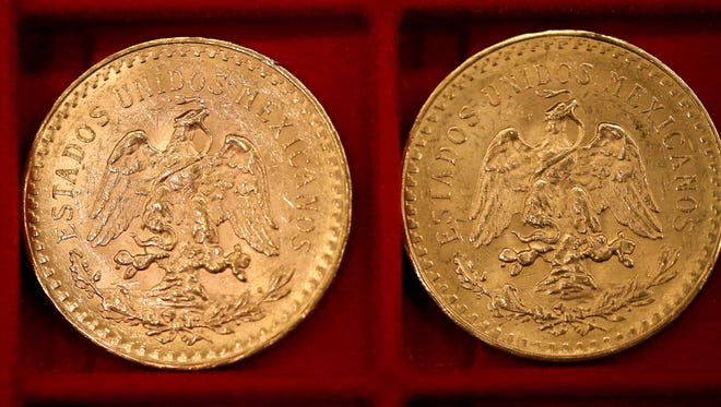 This photo shows gold Mexican 50-peso pieces that once belonged to Walter Samaszko, Jr. that were up for auction in Carson City, Nev. in February. Another auction Tuesday at the Carson City courthouse includes more than 2,600 coins to be sold in six lots.