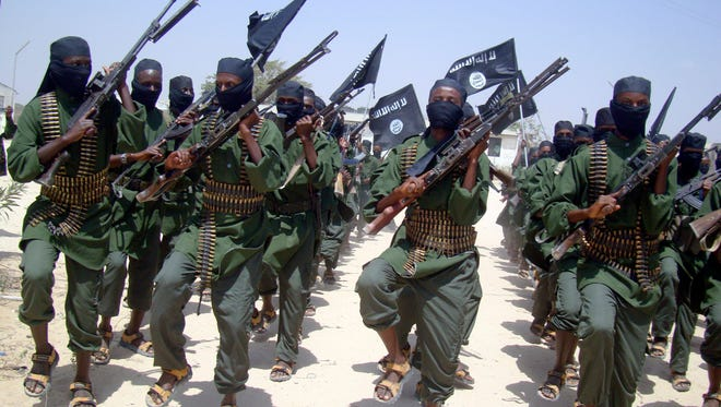 Al-Shabab fighters march on Feb. 17, 2011, during military exercises on the outskirts of Mogadishu, Somalia.