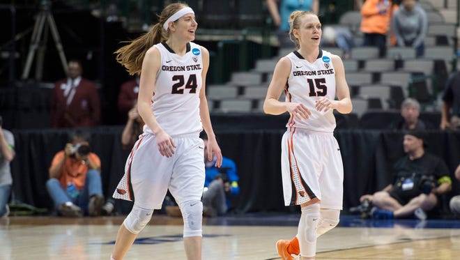 Oregon State guards Sydney Wiese (24) and Jamie Weisner (15) come off the court after the win over DePaul in the semifinals of the Dallas region of the women's NCAA tournament at American Airlines Center.