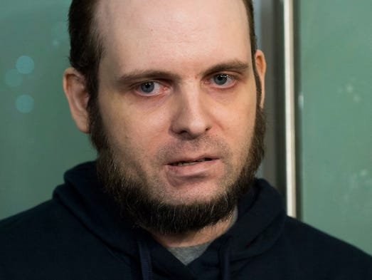 Joshua Boyle speaks to the media after arriving at