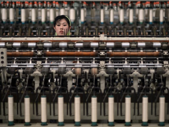 A North Korean woman works in a textile factory in