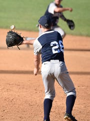 Penn State first baseman Tyler Kendall (32) throws