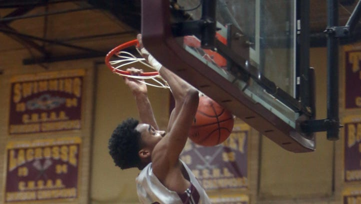 Bryce Wills of Iona Prep dunks the ball during a game