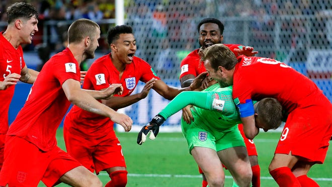 England players celebrate after the win in penalty kicks.