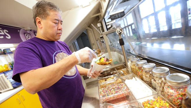 Albert Yee, who has a Bubble Waffle Shoppe stand at UW-Milwaukee Panther Arena, will bring his waffles to US Bank Stadium in Minneapolis for the Super Bowl on Sunday.