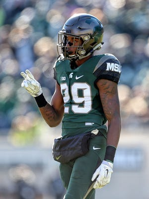 Michigan State wide receiver Donnie Corley gestures to the sideline against Rutgers at Spartan Stadium.