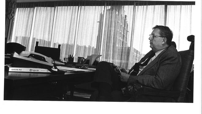 In this September 1987 file photo, William A.V. Cecil sits in his Biltmore Co. office in downtown Asheville. Cecil, a visionary devoted to the estate's success, died Tuesday.