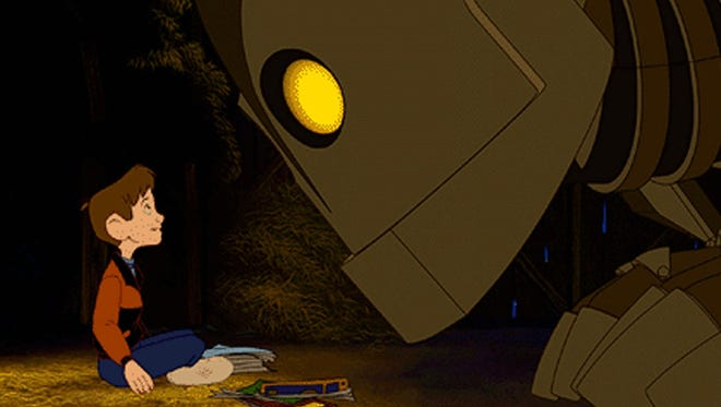 "Hograth left and The Iron Giant appear in a scene from the Warner Bros.' animated adventure ""The Iron Giant."""