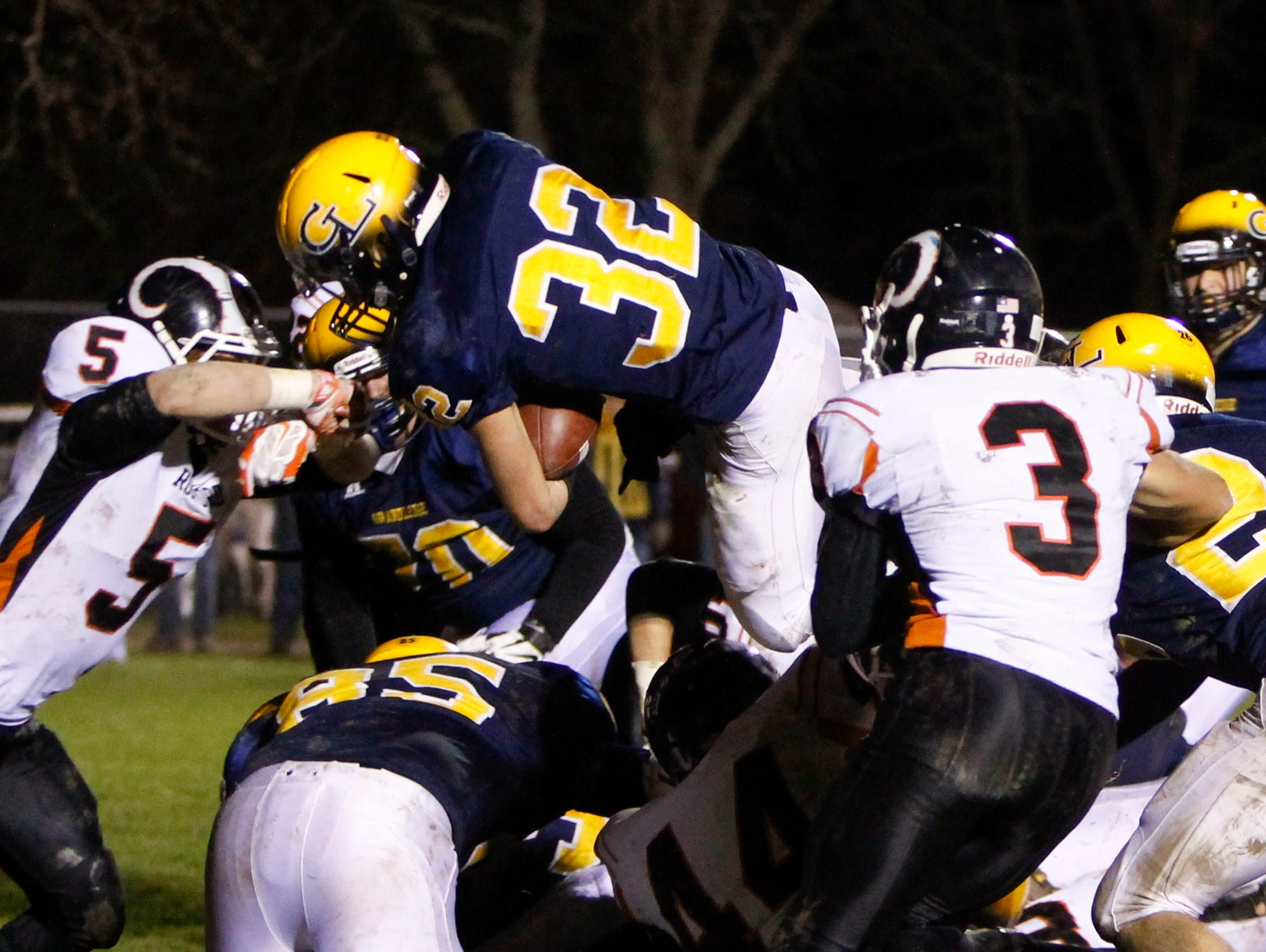 Grand Ledge senior Caden Evert goes up and over the line of scrimmage Friday, November 13, 2015, during the Div. 1 regional final against Rockford for a touchdown. Grand Ledge won 36-16 at home.