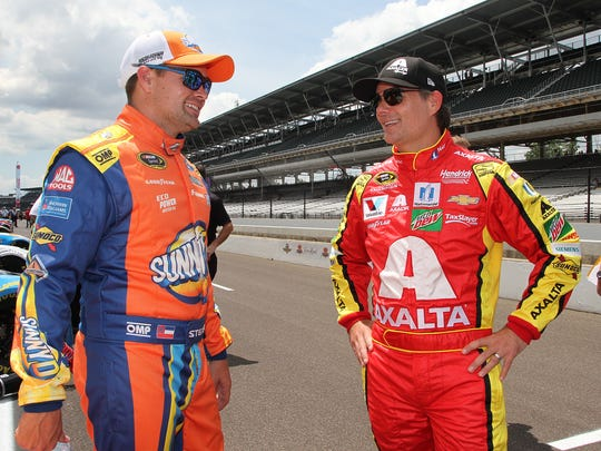 Sprint Cup Series driver Ricky Stenhouse Jr. (17),left, and Jeff Gordon,right, before qualifying for the Brickyard 400 Saturday, July 23, 2016, afternoon at the Indianapolis Motor Speedway.