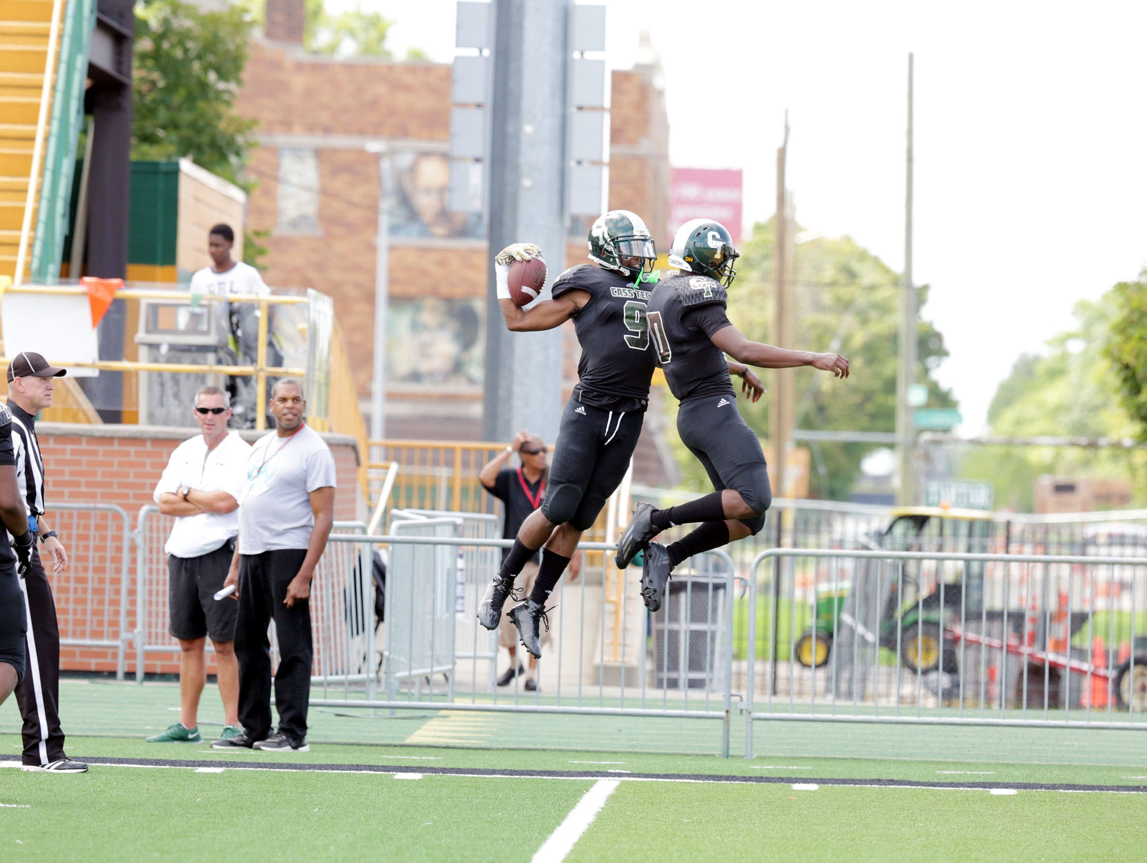 The state's top recruit Donovan Peoples-Jones (9), left, celebrates after scoring a touchdown with his teammate during the first half. He lead Cass Tech to a 45-27 win over Oak Park during the Detroit Prep KickOff Classic Sunday, Aug. 28, 2016 at Wayne State University's Tom Adams football field. Regina H. Boone/Detroit Free Press