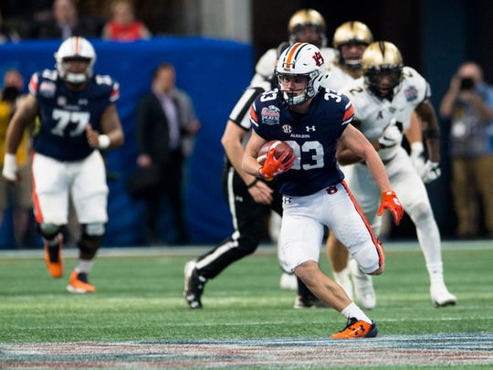 Auburn wide receiver Will Hastings (33) runs downfield during the second half of the Peach Bowl between Auburn and UCF on Monday, Jan. 1, 2018, at Mercedes-Benz Stadium in Atlanta, Ga.
