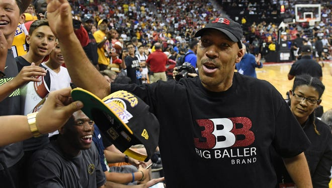 LaVar Ball, father of Lonzo Ball #2 of the Los Angeles Lakers, greets fans at halftime of a 2017 Summer League game between the Lakers and the Los Angeles Clippers at the Thomas & Mack Center on July 7, 2017 in Las Vegas, Nevada.