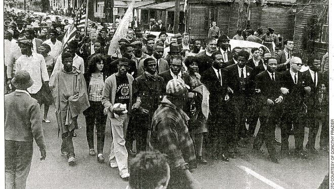 From left, unidentified man, Timothy May, unidentified man, Dorothy Frazier, Ralph Abernathy, James Forman, Martin Luther King Jr., Jessie Davis and John Lewis lead marchers in the Selma-to-Montgomery march on March 17, 1965. The man on the far left of the front row of marchers wears an Alabama State shirt.