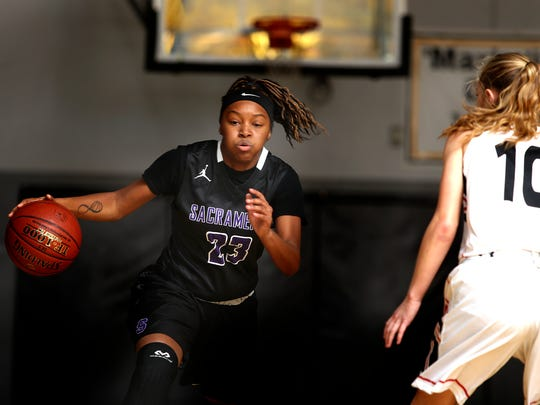Sacramento High's RyAnne Walters takes the ball past Foothill's Melissa Mitchell during Foothill's loss Thursday at the opening night of the 2017 girls Harlan Carter Invitational.