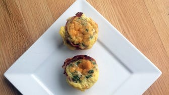Egg cups are wrapped in partially cooked bacon and can be tailored to individual tastes.