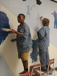 painting a mural at Valley Springs Middle School