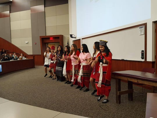 Members of the Burnese community perform a dance in