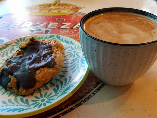The Egg Nog Latte ($4) and the Chocolate Pumpkin Cookie ($2) offered at The Bean Café of Mesilla.
