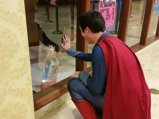 Isn't this adorable? Space Coast Superman reaches out to a very young fan.