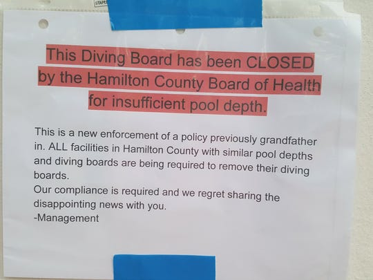 The sign at Oak Hills Swim Club, one of three pools asked by officials at the Hamilton County Board of Health to close a diving board for insufficient water depth.