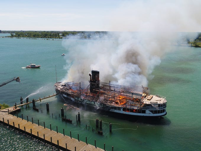Firefighters battle a blaze on the SS Ste. Claire,