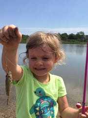 Lavender Young, age 4, catches her first fish at Nelson Park. She is the granddaughter of Debbie and Downing Bolls.