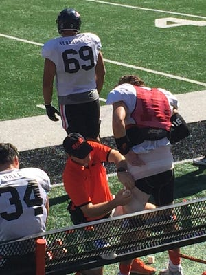 OSU cornerback Darell Garretson has his left thigh wrapped during Thursday's scrimmage at Reser Stadium.