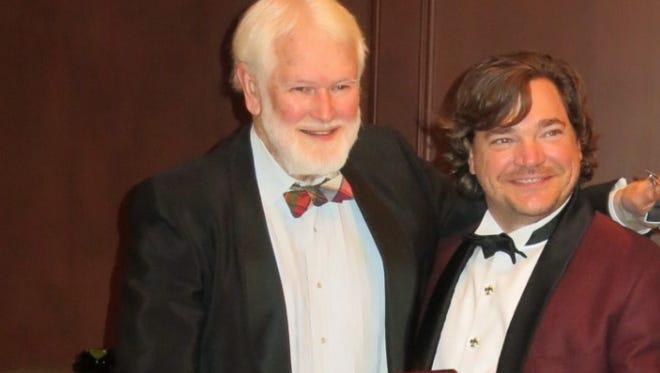 Dr. Larry Embree receives award from Shreveport Medical Society Prez Dr. Russ Van Norman III at dinner.