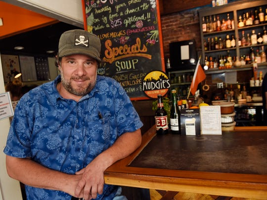 Greg Mudge, owner of Mudgie's Deli & Wine, wonders