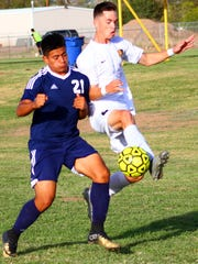 Alamogordo's Kamrynne Davis, right, tries to get past Deming's Paul Saucedo.
