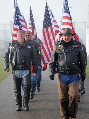 Members of the Ohio Patriot Guard escorted U.S. Navy Builder Chief Petty Officer Raymond Border's body from Richard Downing Airport to Miller Funeral Home, in addition to assisting at the funeral home. Patriot Guard Riders are comprised of citizens, many of them veterans, who ride and stand watch to honor service members and their families.