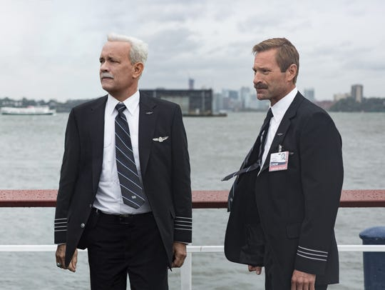 """Chesley """"Sully"""" Sullenberger (Tom Hanks, left) and"""
