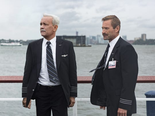 "Chesley ""Sully"" Sullenberger (Tom Hanks, left) and Jeff Skiles (Aaron Eckhart) are initially seen as heroes in ""Scully."""