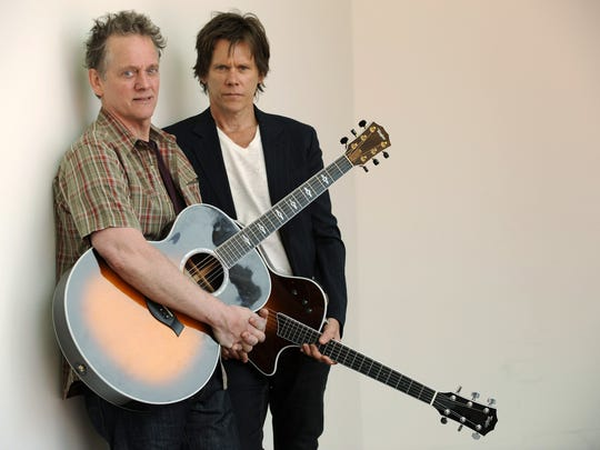 FILE - In this  March 25, 2009 file photo, Michael Bacon (left) and Kevin Bacon of The Bacon Brothers pose for a portrait in Los Angeles.