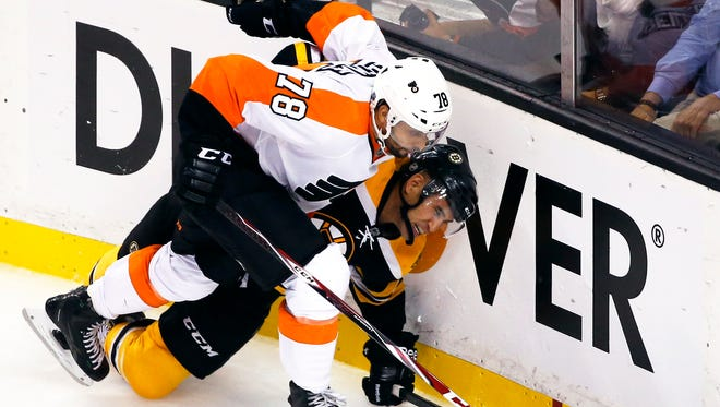 Philadelphia Flyers right wing Pierre-Edouard Bellemare (78) and Boston Bruins center Bobby Robins, right, battle for the puck along the boards in the third period of an NHL hockey game in Boston, Wednesday, Oct. 8, 2014. The Bruins won 2-1. (AP Photo/Elise Amendola)